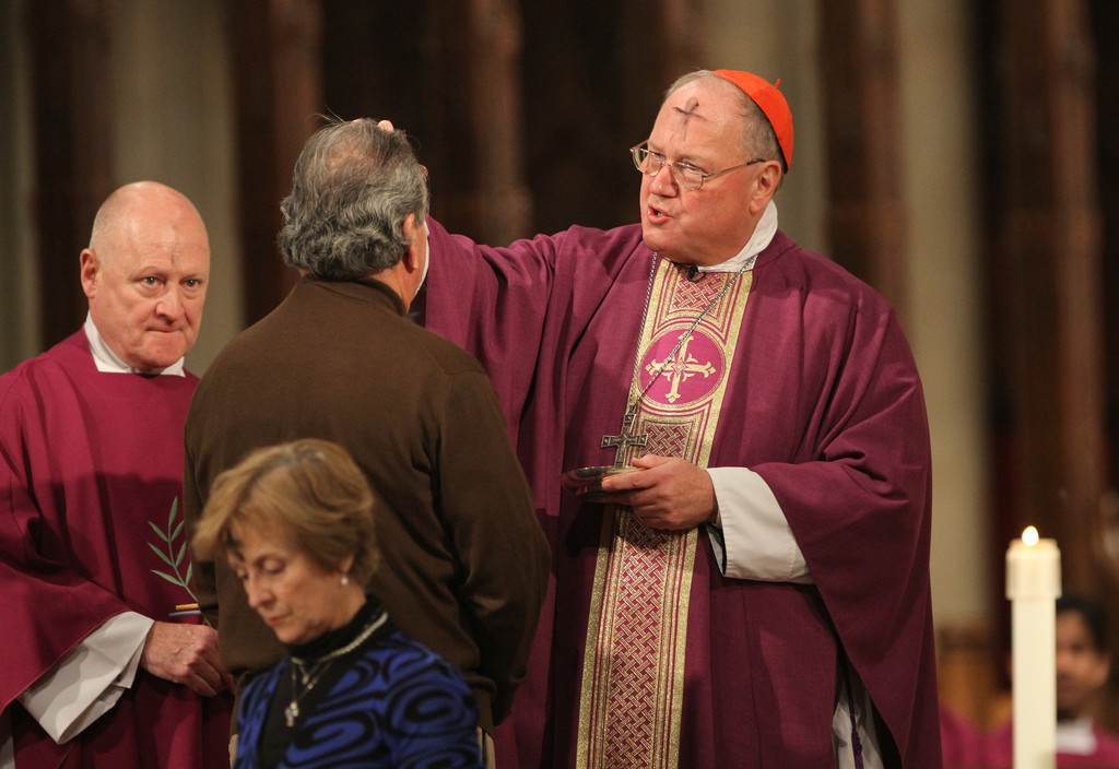 DUST TO DUST—Cardinal Dolan imposes ashes on the forehead of a man during a Mass at St. Patrick's Cathedral on Ash Wednesday, Feb. 13.