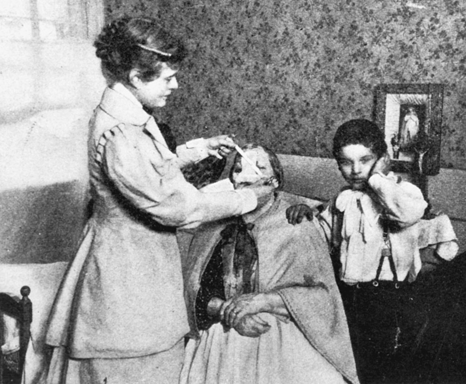 Rose Hawthorne Lathrop, who was known in religion as Mother Alphonsa, tends to a sick woman in the tenement hospice she started in the late 1890s while still a lay Catholic woman.