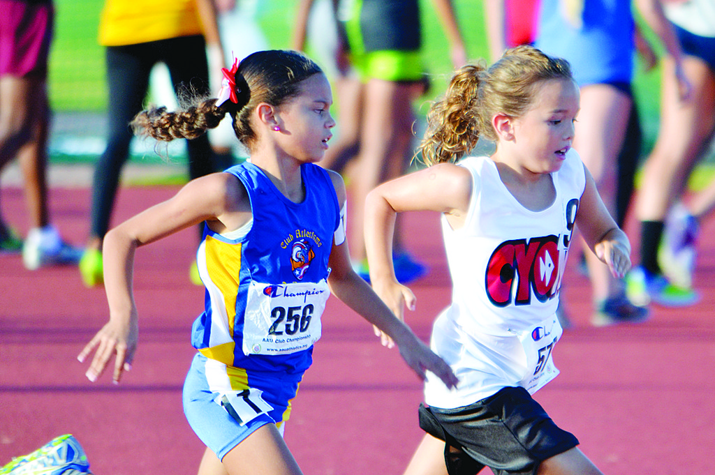 MOVING AHEAD—Rory Sheridan, right, of Annunciation in Crestwood gives it her all in the 800-meter run at the AAU Track and Field Championships earlier this month in Orlando, Fla. Forty-two CYO athletes traveled to the annual Florida meet.