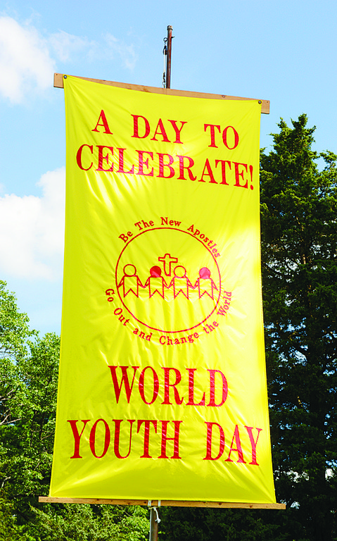 "FAITH FESTIVAL—A banner marks the spot of the Parish Visitors of Mary Immaculate's ""World Youth Day—Not a World Away,"" at Marycrest Convent in Monroe, July 26-28. The sisters hosted high school and college age young adults for a schedule that included skits and workshops, along with Masses and Holy Hours."