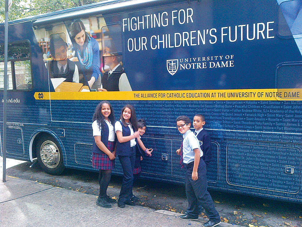 Pupils find the name of their school inscribed on the bus.