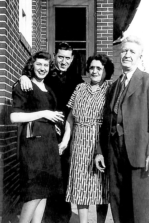 CLOSE TIES—Father John J. O'Connor with his sister, Mary, and parents, Dorothy and Thomas, at friend's home in Norwood, Pa., in 1946.