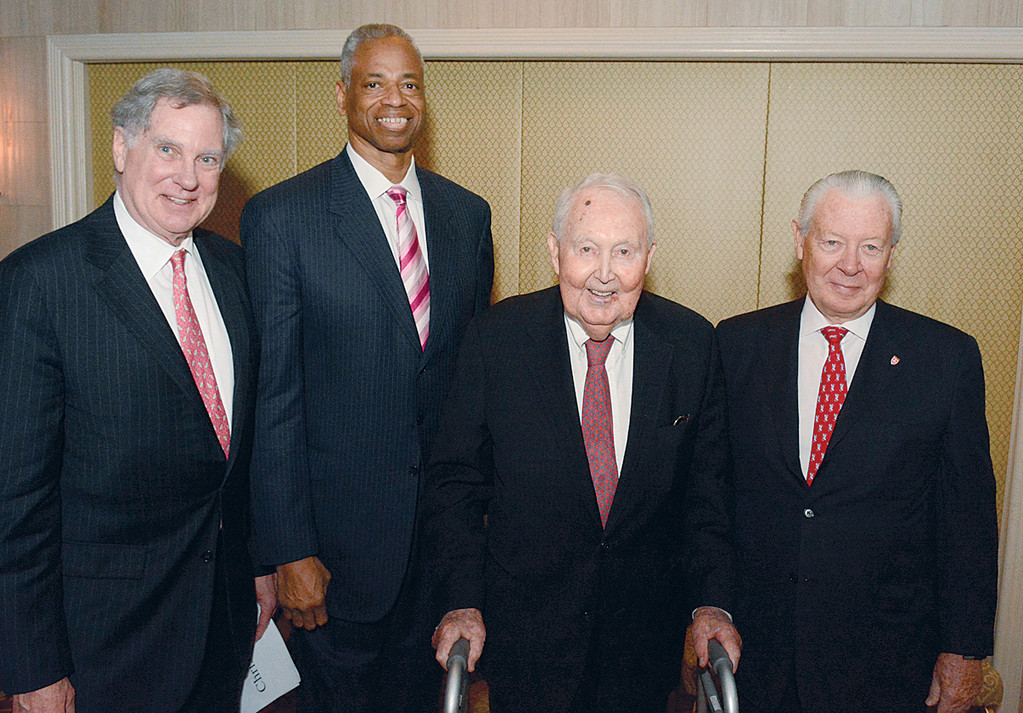 CYO Board President Chris Gallagher, left, stands with this year's honorees at the annual CYO Club of Champions Tribute at the Waldorf Astoria. To his right are:  Leonard Elmore, recipient of the John V. Mara Sportsman of the Year Award; Francis Rooney, winner of the Terence Cardinal Cooke Humanitarian Award; and Timothy Rooney, Gold Medal recipient.