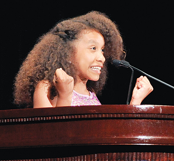 Olivia Barrios-Johnson, a sixth-grade student at St. Francis of Assisi School, the Bronx, delivers her award-winning essay on fitness at the dinner.