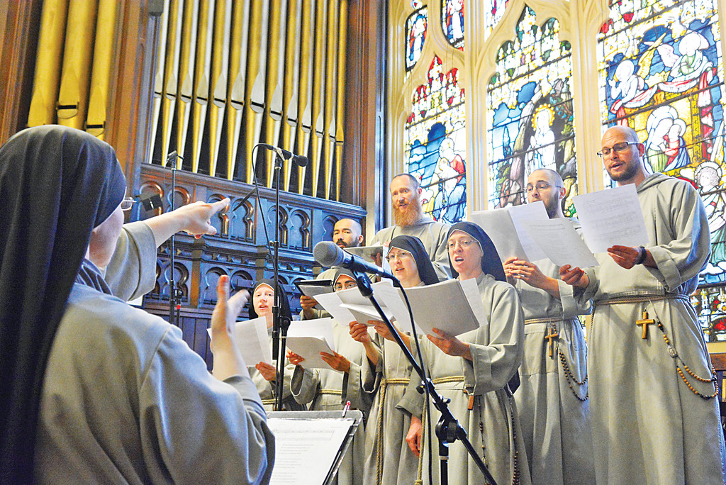 Franciscan Friars and Sisters of the Renewal sing in praise at a June 28 Mass at Our Lady of Good Counsel Church in Manhattan where four sisters professed their final vows with the religious community. Cardinal Dolan was the principal celebrant, and concelebrants included Father Andrew Apostoli, C.F.R., a co-founder of the community. Also participating were Sister Lucille Cutrone, C.F.R., the community servant (superior) and Sister Clare Matthiass, C.F.R., community vicar.