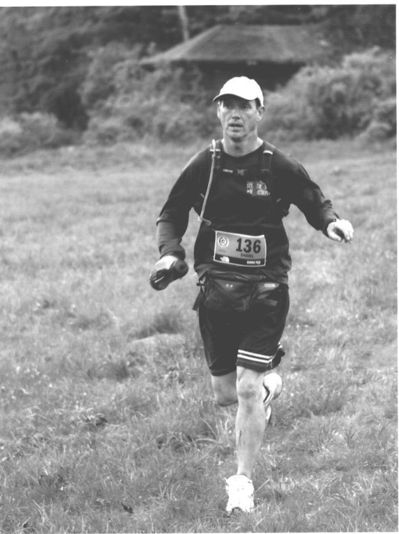 Cardinal Spellman principal Daniel O'Keefe logs miles during a recent ultra-marathon event. The Spellman principal hopes to run 100 miles in 24 hours on the school track to raise funds and to set an example for his students.