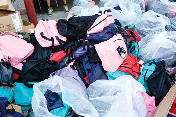 Three hundred boys filled more than 1,000 bags for the service project.