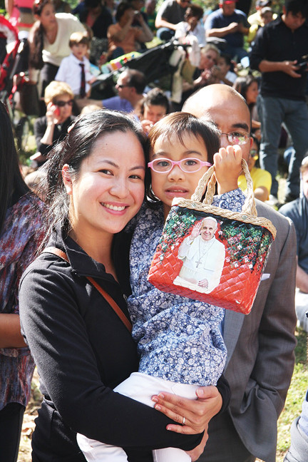Fans include this adorable girl holding a papal purse as she and her family wait for the pope in Central Park.