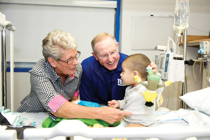 COMPASSION—New York Giants Coach Tom Coughlin and his wife, Judy, visit a young cancer patient at St. Joseph's Region Medical Center in Paterson, N.J.