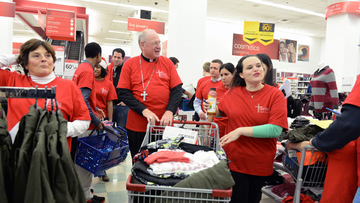 Cardinal Dolan pushes his cart full of items for the St Nicholas Project today at KMART.