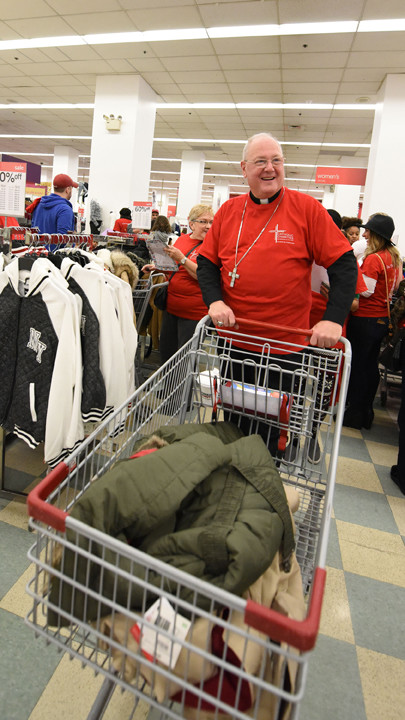 Cardinal Dolan pushes his shopping cart.