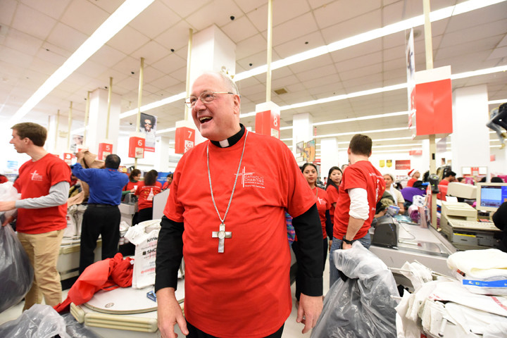 Cardinal Dolan smiles at the checkout counters.