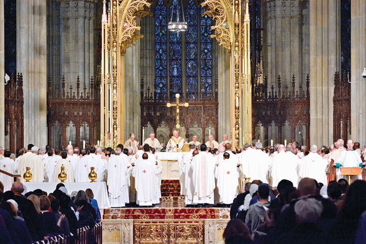 Cardinal Dolan is joined by priests of the archdiocese at the Chrism Mass March 22 at St. Patrick's Cathedral, where holy oils used in the administration of the sacraments are poured into vessels and blessed for use in parishes.