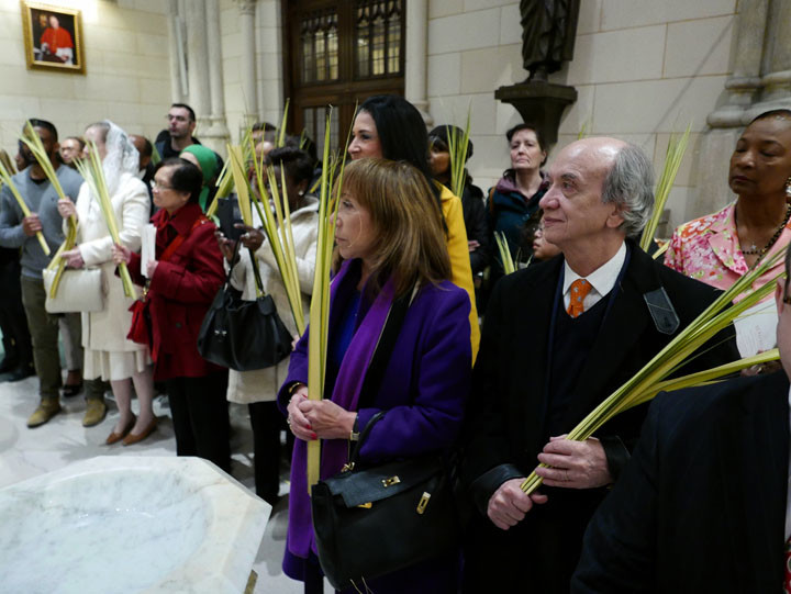 Palm fronds are distributed on Palm Sunday, like the ones seen in the hands of those attending Mass at St. Patrick's Cathedral.