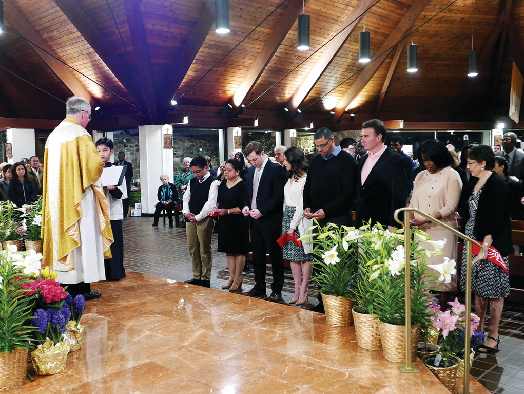 Father Joseph Deponai, pastor, confirms four—SirrCarlo Timbang, Matthew Miller, Jose Lopez and Sandra Costley-