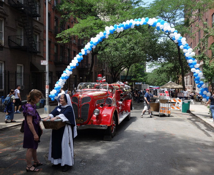 Sister Mary, S.V., talks with a visitor. Behind her is a fire truck that children were allowed to explore for the day.
