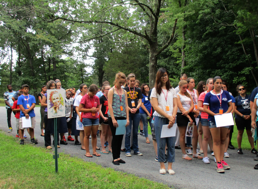 "Teens and young adults participate in a pilgrimage walk at the ""World Youth Day—Not a World Away'' retreat at Marycrest in Monroe on July 30. Fifty teens and young adults took part in the three-day retreat."