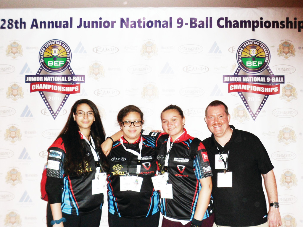 Cathedral High School students, from left to right, Eliana Rodriguez, Kharmalina Tong and Ariana Dumeng were the school's first participants at junior nationals, held last month in Schaumburg, Ill. Moderator Mike Muldoon, right, started the club sport at Cathedral in 2002.