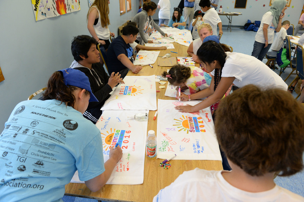 Summer fun is a sure thing at Sunrise Day Camp on Staten Island.  Campers sign keepsake pillowcases.