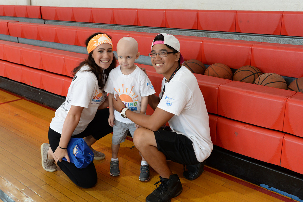 Summer fun is a sure thing at Sunrise Day Camp on Staten Island. Emily Deddo, a camp counselor, is all smiles, as are camper Anthony Guarnieri and camp counselor Nico Baylosis.