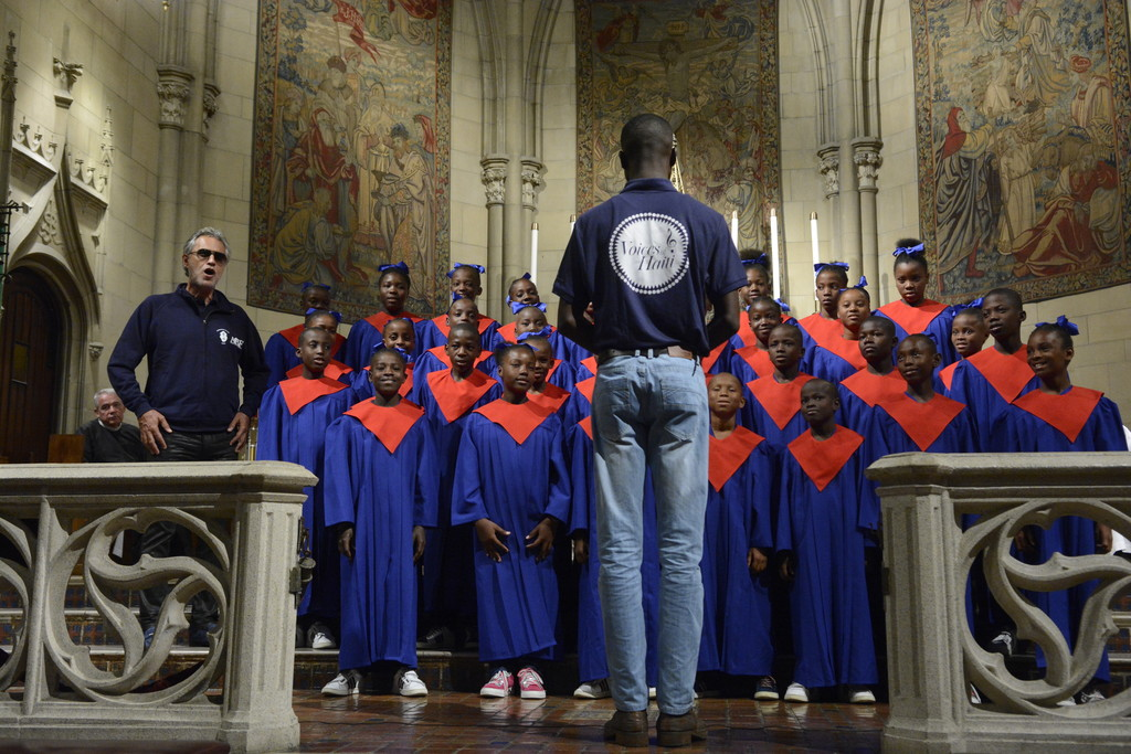 "35 children in the Voices of Haiti choir sing ""Ave Maria"" with world-renowned Italian tenor Andrea Bocelli, far left, at Mass in Blessed Sacrament Church in Manhattan on Sept. 18. The 8:30 a.m. liturgy was standing room only, and parishioners eagerly welcomed the guests and expressed their appreciation for the post-Communion selections. Choir members also performed with Bocelli at two other New York City concerts."