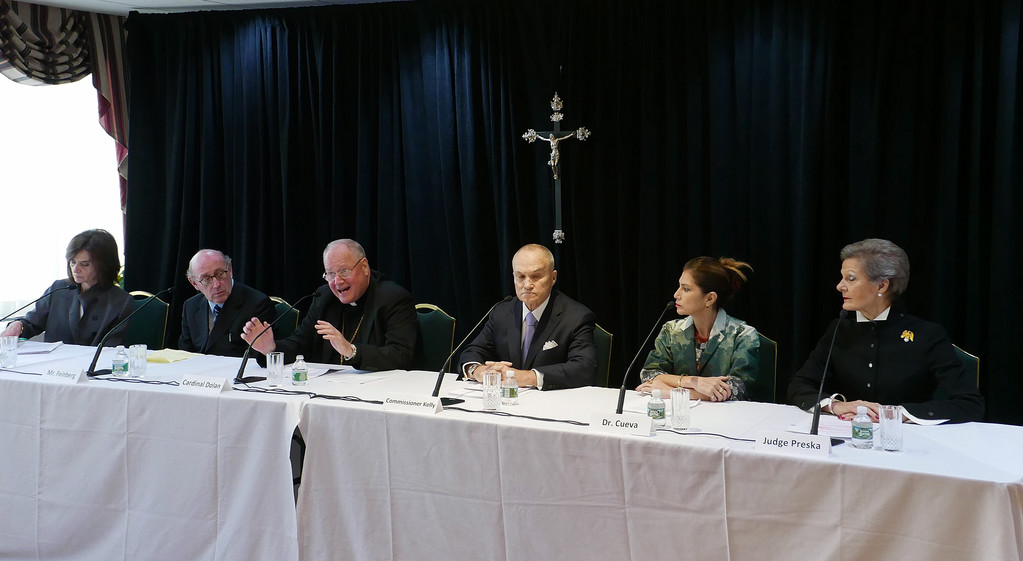 QUALIFIED TEAM—Cardinal Dolan speaks at the Oct. 6 news conference to introduce the voluntary Independent Reconciliation and Compensation Program for victim-survivors of sexual abuse as minors by clergy of the archdiocese. Joining the cardinal at the New York Catholic Center in Manhattan were, from left, Camille Biros and mediator Kenneth Feinberg, who will work together as the program's administrators, and former New York City Police Commissioner Raymond Kelly, Dr. Jeanette Cueva, M.D., and federal Judge Loretta Preska, who will each serve on the program's oversight committee.