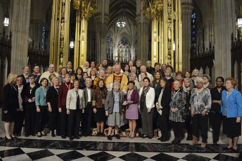 Cardinal Dolan joins the newly affiliated Ladies of Charity for a group photo at St. Patrick's Cathedral on Oct. 22.