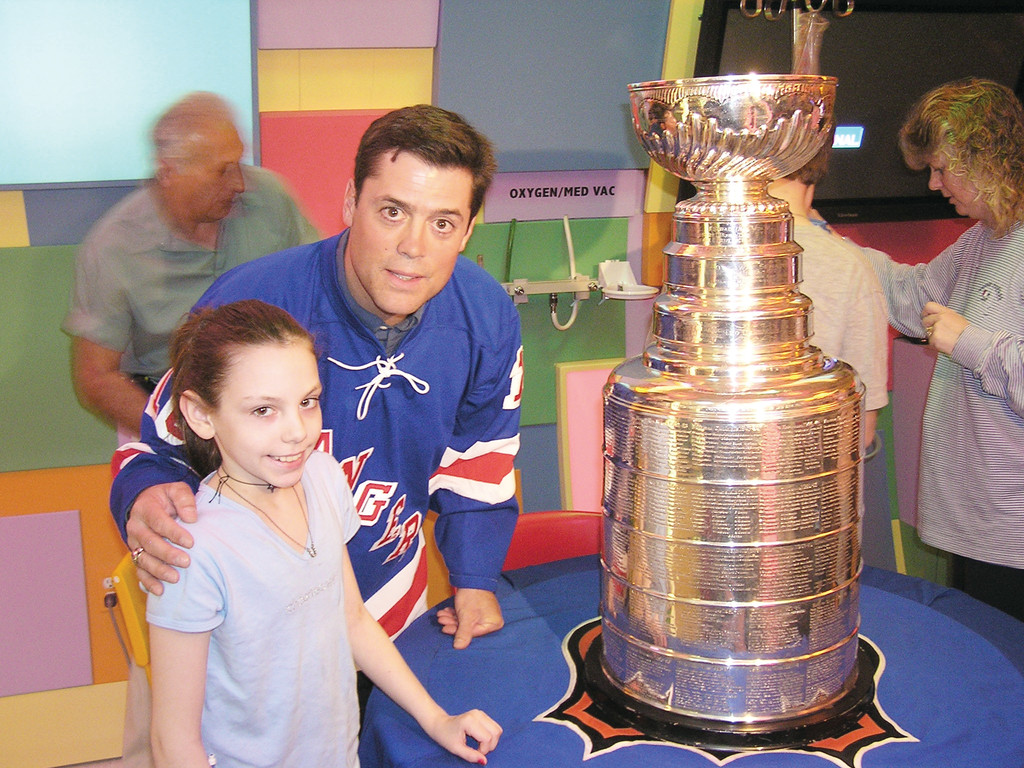 National Hockey League Hall of Famer Pat LaFontaine and a young patient view the Stanley Cup at the Maria Fareri Children's Hospital in Valhalla.