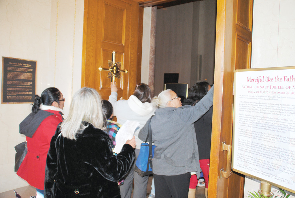 Pilgrims from the Archdiocese of New York pass through the Holy Doors at the Basilica of the National Shrine of the Immaculate Conception in Washington, D.C., on Oct. 15.