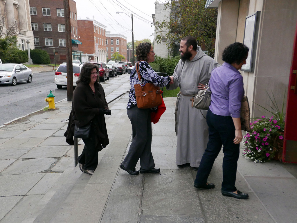 Brother Philip Maria Allen, C.F.R., greets people outside St. Patrick's Church.