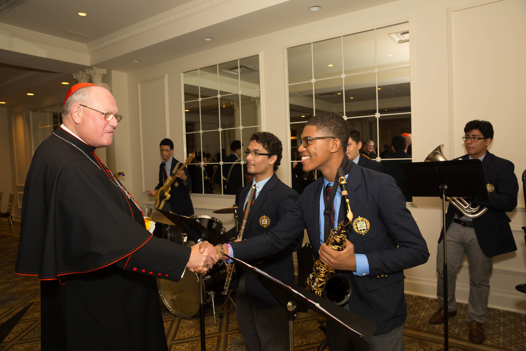 Cardinal Dolan greets Marlon Morrison, one of the school band members who performed during the 75th Anniversary Gala at The Plaza Hotel in Manhattan on Oct. 21.