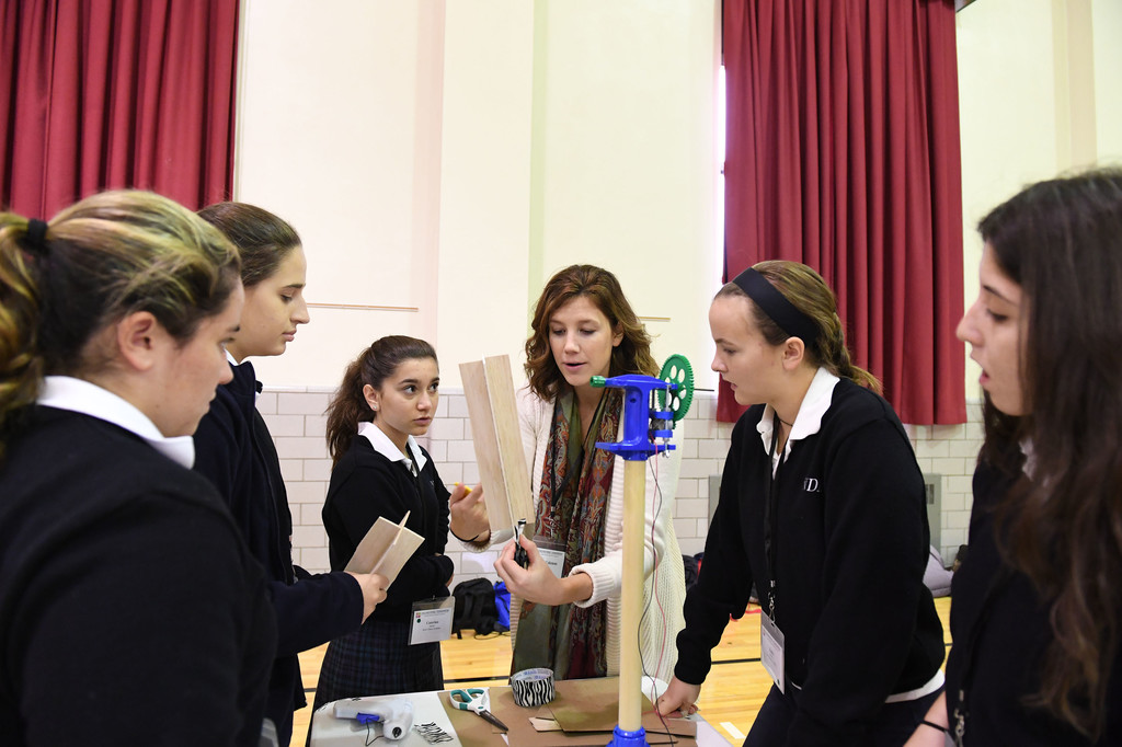 General Electric civil engineer Alexandra Coleman, center, assists Notre Dame Academy High School students Hope Tulino, Samantha Doyle, Caterina Raineri, Emily Jaenicke and Valerie Ribertelli at a STEM conference led by the Engineering Tomorrow foundation at Notre Dame Academy, Staten Island, on Oct. 28.