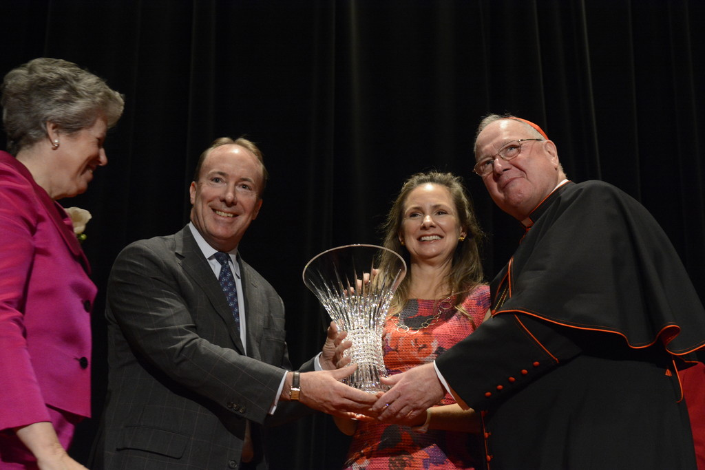 Whitney and Clarke Murphy receive the Spirit of St. Nicholas Award from Cardinal Dolan and Mary Buckley Teatum, president of the Ladies of Charity