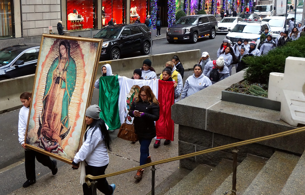 WITH OUR LADY—Many people walk in procession outside St. Patrick's Cathedral behind an image of Our Lady of Guadalupe  after a youth Mass on her feast day, Dec. 12. Two Masses were offered in her honor at the cathedral that day.