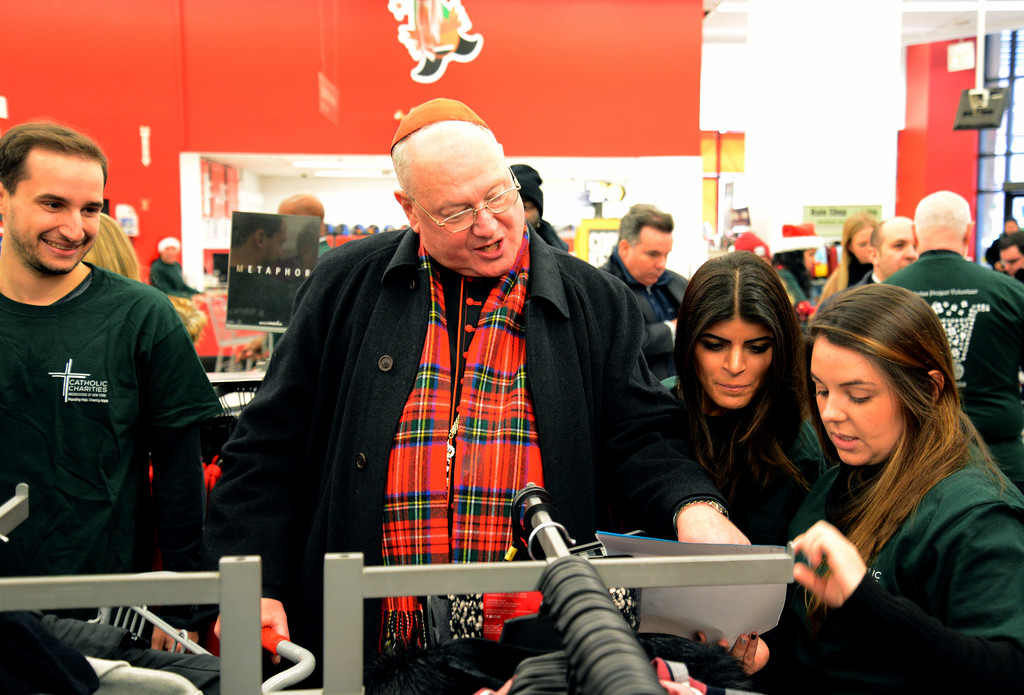 Cardinal Dolan happily helps out at the annual St. Nicholas Shopping Day at Kmart Astor Place hosted by Catholic Charities of the archdiocese.