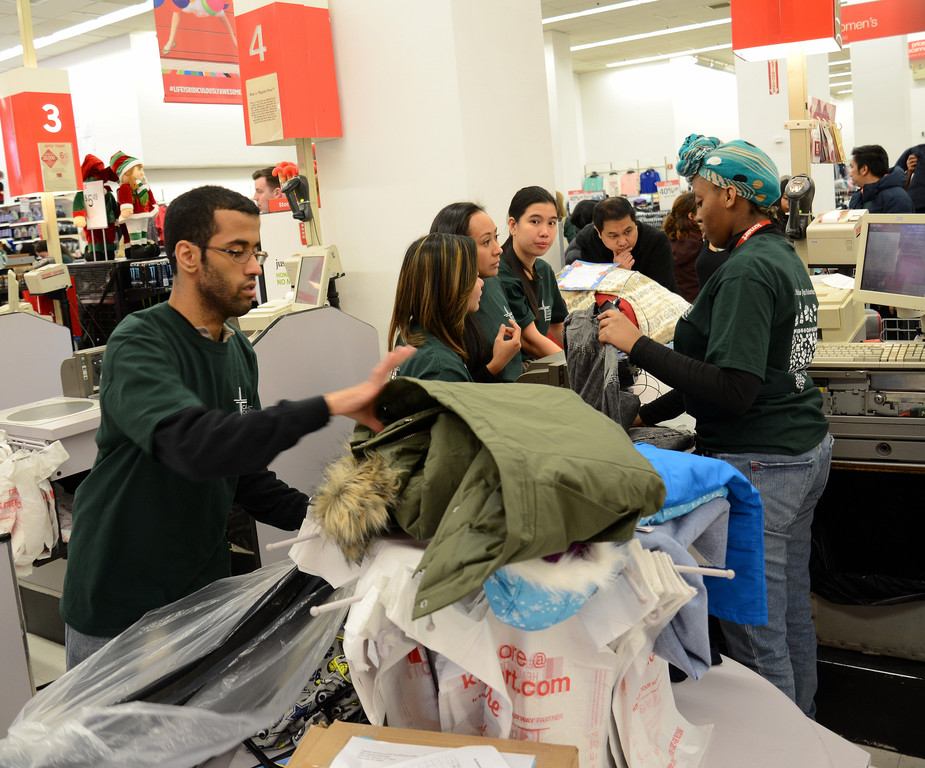 The St. Nicholas Project Shopping Day is in full swing on Saturday morning, Dec. 10, at Kmart Astor Place in Manhattan.