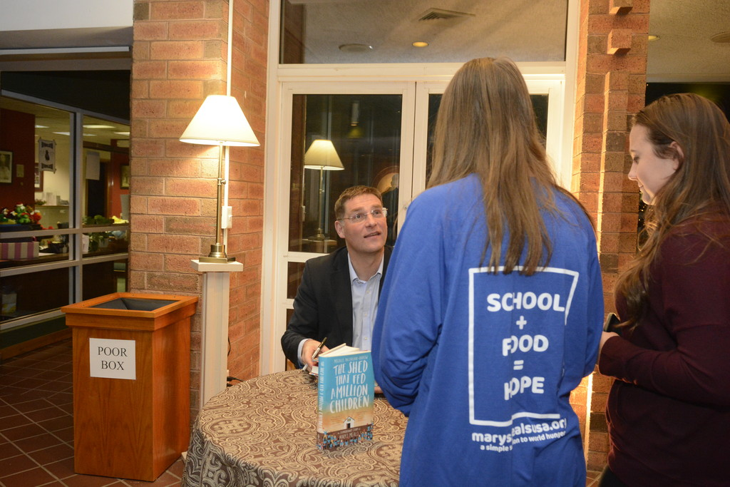 "Magnus MacFarlane-Barrow, founder and CEO of Mary's Meals, signed his book, ""The Shed That Fed a Million Children,'' following his talk at St. Stephen the First Martyr Church in Warwick on Dec. 14. Money raised from book sales was donated to Dzungwi Primary School in Malawi, the parish's adopted school, via Mary's Meals."