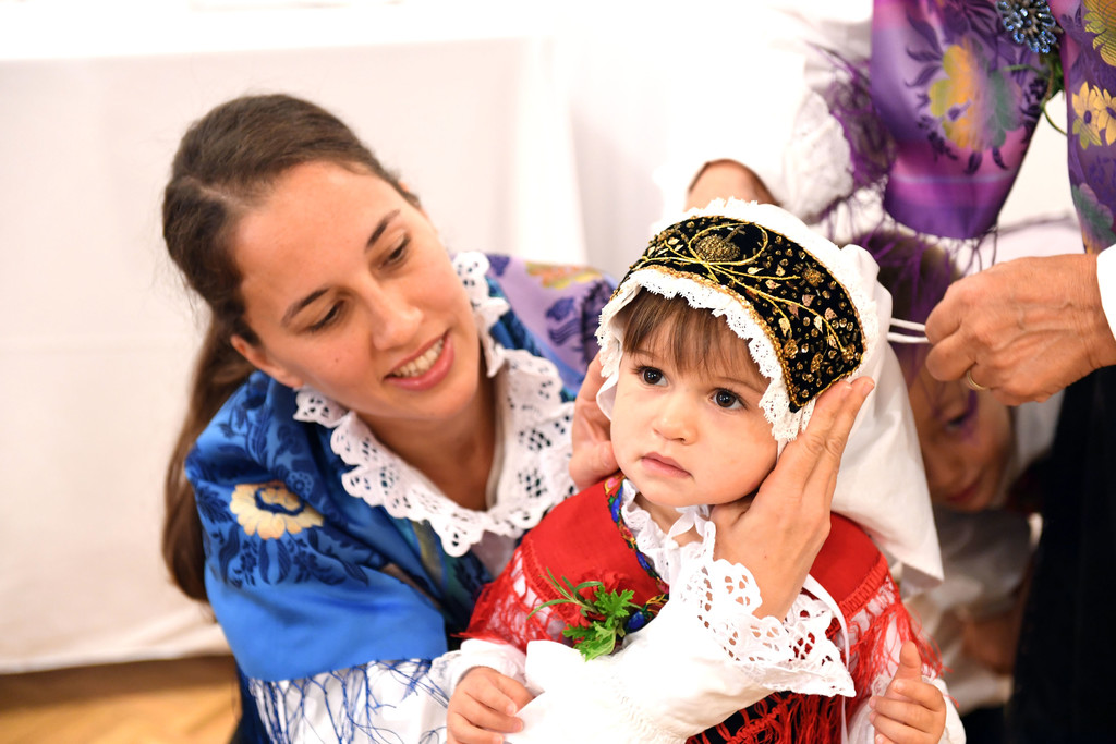 Wearing traditional Slovenian attire are Olga Burger and her daughter Zarja ZuZu Clifton for St. Cyril's centennial anniversary.