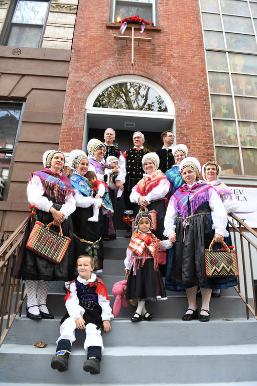 Parishioners gather on the steps of St. Cyril's Church in Manhattan for the parish's Centennial Mass on Oct. 16.