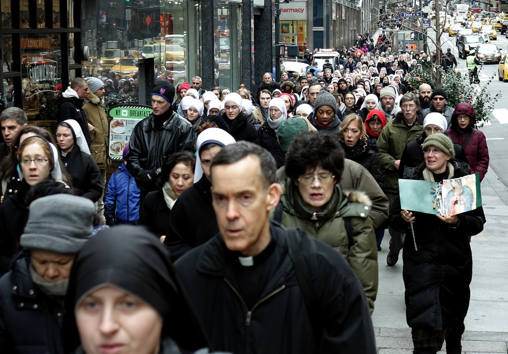 Father Donald Haggerty, a parochial vicar at St. Patrick's Cathedral, joins hundreds of others in a prayerful procession to the Parkmed abortion clinic in Manhattan on Dec. 28. Father Haggerty delivered the homily at a pro-life Mass to mark the Feast of the Holy Innocents at Holy Innocents Church.
