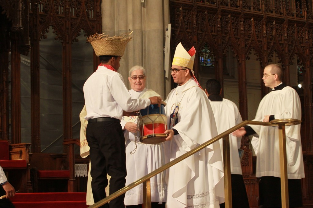 Bishop Hector Rafael Rodriguez Rodriguez receives gifts at the offertory.