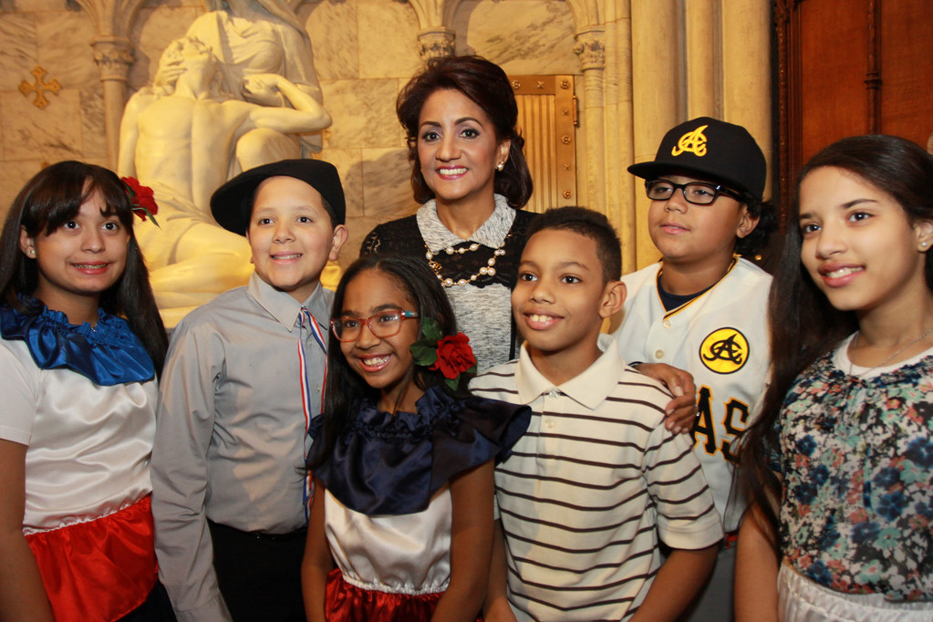 FIRST LADY HONORS OUR LADY—First Lady of the Dominican Republic Candida Montilla de Medina meets with children who participated in the Our Lady of Altagracia Mass at St. Patrick's Cathedral on Jan. 15.