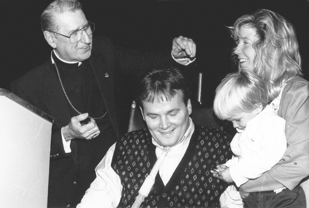 FAMILY PORTRAIT—Cardinal John O'Connor smiles with the McDonald family, Steven, Patti Ann and young Conor, at the Friends of the Cardinal Cooke luncheon in September 1989. The cardinal presented the married couple with the Cardinal Cooke Right to Life Award.