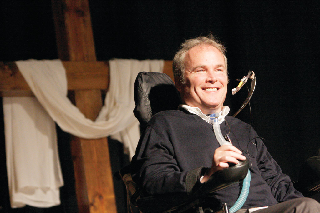 FAITHFUL VOICE—Detective Steven McDonald of the New York Police Department, who was shot and paralyzed in the line of duty in 1986, smiles as he addresses the audience during a Catholic men's conference at Holy Trinity Diocesan High School in Hicksville in 2009. McDonald died Jan. 10 at a Long Island hospital at age 59.