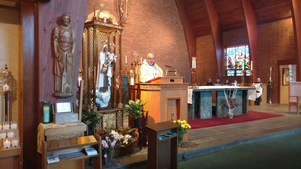 Father Francis Amodio, O. Carm., offers Mass on Feb. 4 at the National Shrine of Our Lady of Mount Carmel in Middletown. The liturgy was in conjunction with a celebration for the 2017 Fatima Centennial Year, and included the enthroning of an historic statue of the Blessed Mother.