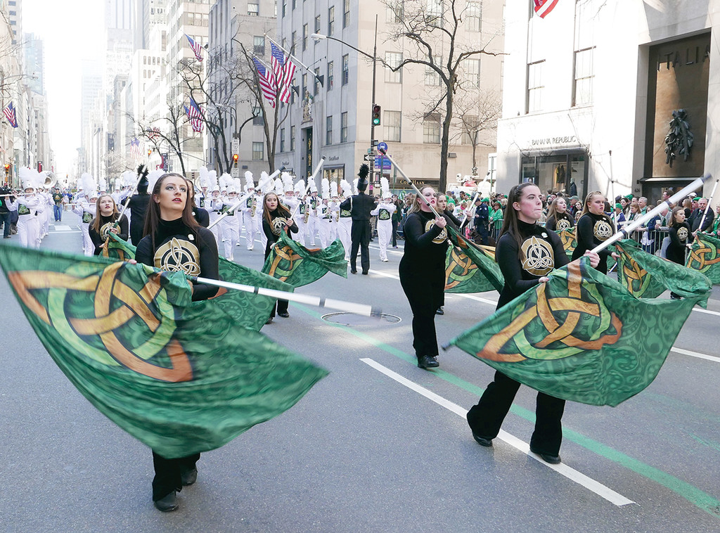 WEARING OF THE GREEN—Parade participants keep in step along Fifth Avenue during the 255th New York City St. Patrick's Day Parade last year.