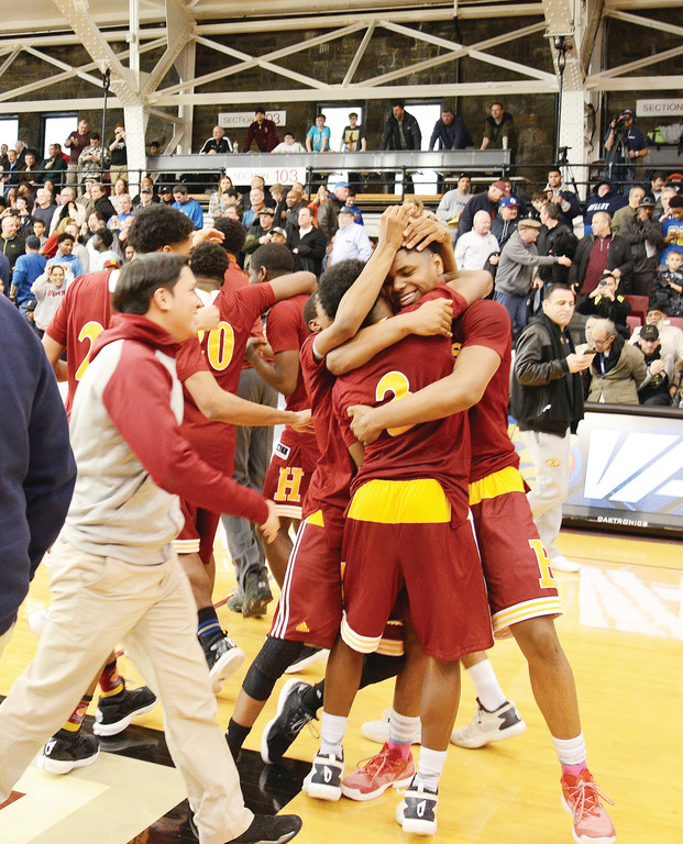 Cardinal Hayes High School players celebrate winning the AA Division New York State CHSAA championship with a 64-62 victory over Archbishop Molloy at Fordham University March 12. Cardinal Hayes will play in the New York State Federation Tournament of Champions in Glens Falls on March 24-26.