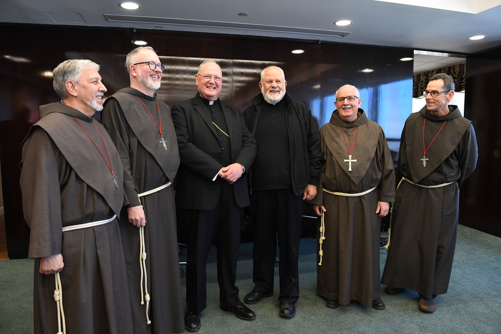 Father James Puglisi, S.A.; Father Brian Terry, S.A.; Cardinal Dolan; Father Emil Tomaskovic, S.A.; Father Charles Sharon, S.A., and Father Daniel Callahan, S.A., gather following the closing of the cause.