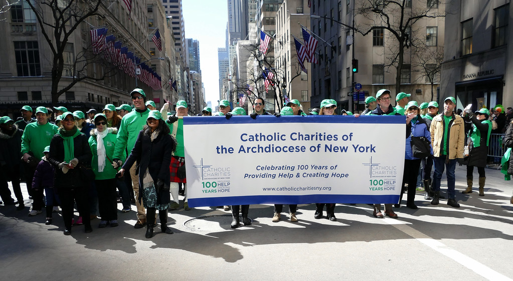 A large contingent of marchers from Catholic Charities of the Archdiocese of New York line up behind their banner. The New York City St. Patrick's Day Parade paid special tribute to Catholic Charities and the New York State Police, both of which are marking their centennial.