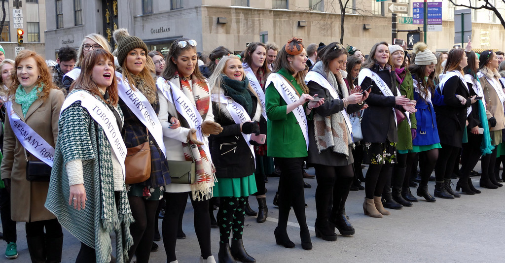 Rose of Tralee international festival participants serenade the crowd at the St. Patrick's Day Parade. The women represent the different counties of Ireland as well as the Irish communities of other cities and nations around the globe.